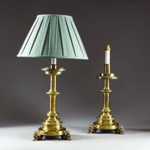 A pair of brass table lamps and shades