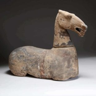 A RARE POTTERY FIGURE OF A HORSE - HAN DYNASTY (206 BC-AD 220)