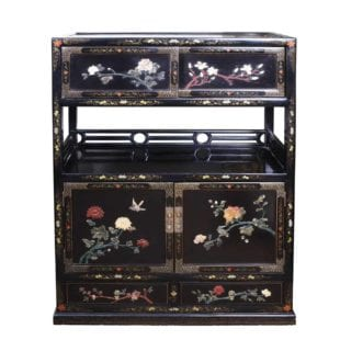 Chinese black Lacquer Cabinet with an open shelf below sliding cupboard doors and above a pair of cupboard doors and drawers, all with cut hard stones arranged as flowering branches.
