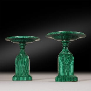 A pair of small scale Malachite tazzas. Each veneered on a metal frame with book-matched malachite. Attributed to the Demidoff workshops. Russia circa 1830. Height 7 Inches.