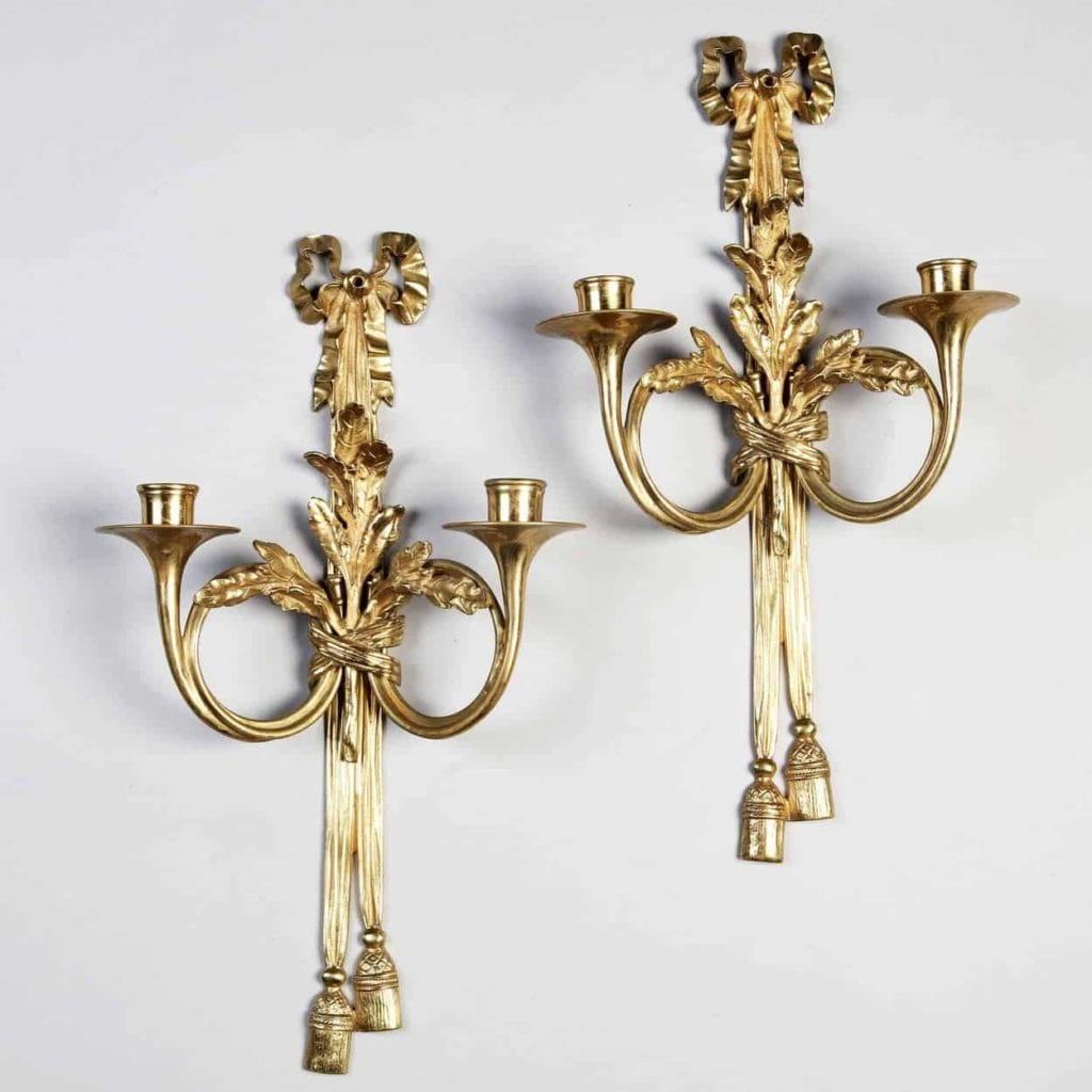 Pair of French 19th century neo-classical wall appliques, each with two arms fashioned as French horns
