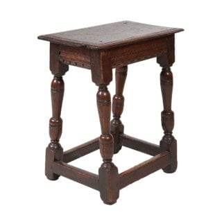 A early-17th century oak joint stool