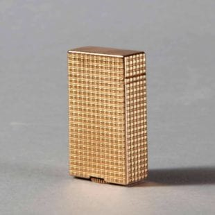A very rare miniature solid 18k gold Dunhill Petrol cigarette lighter.