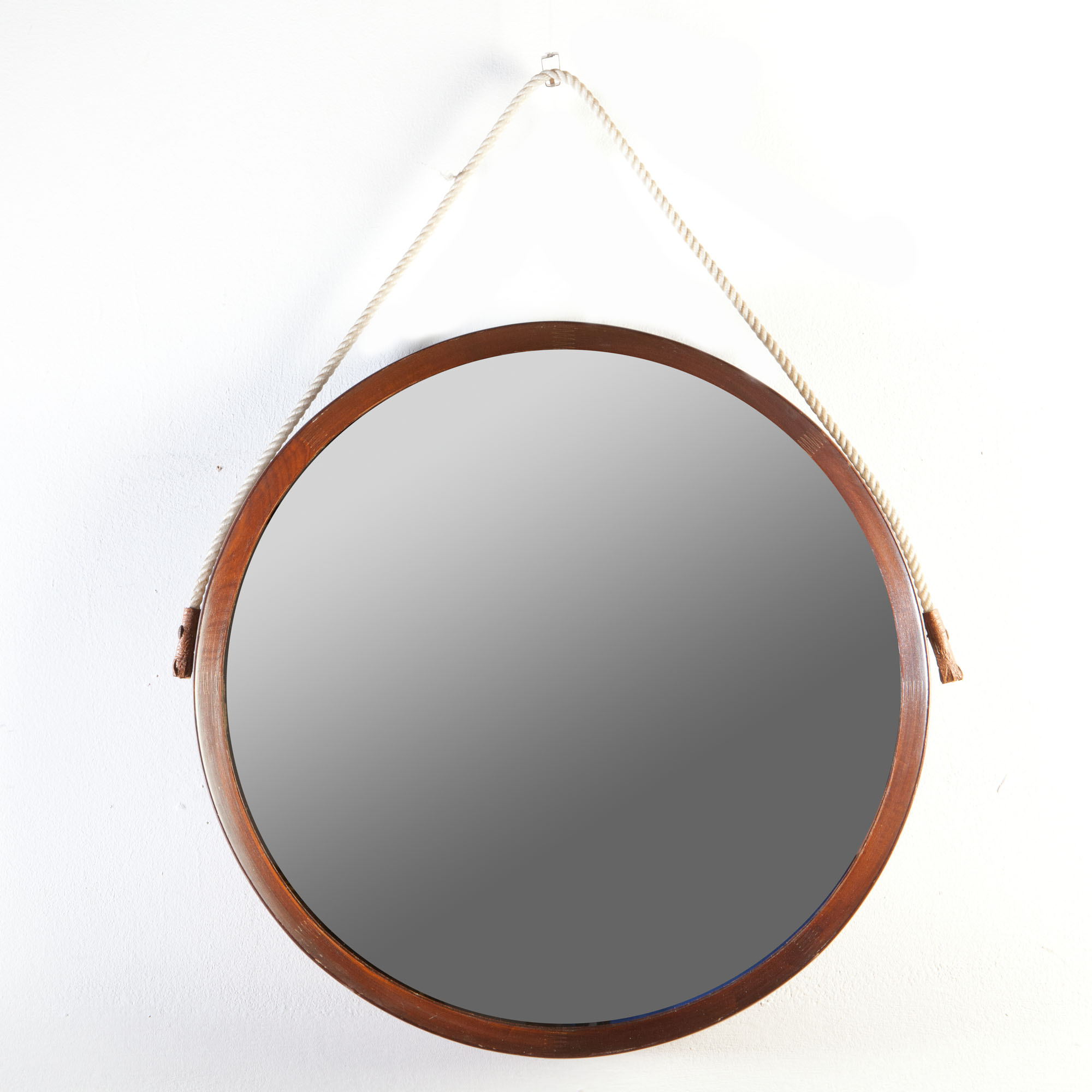 An Italian 1970s circular mirror with a rope