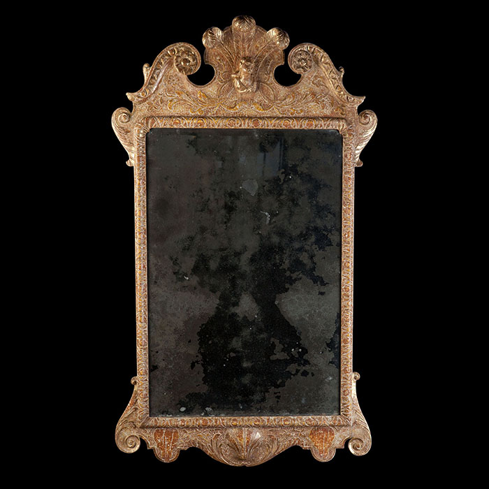 Early 18th century Queen Anne Mirror in a giltwood frame, retaining its original mercury mirror plate