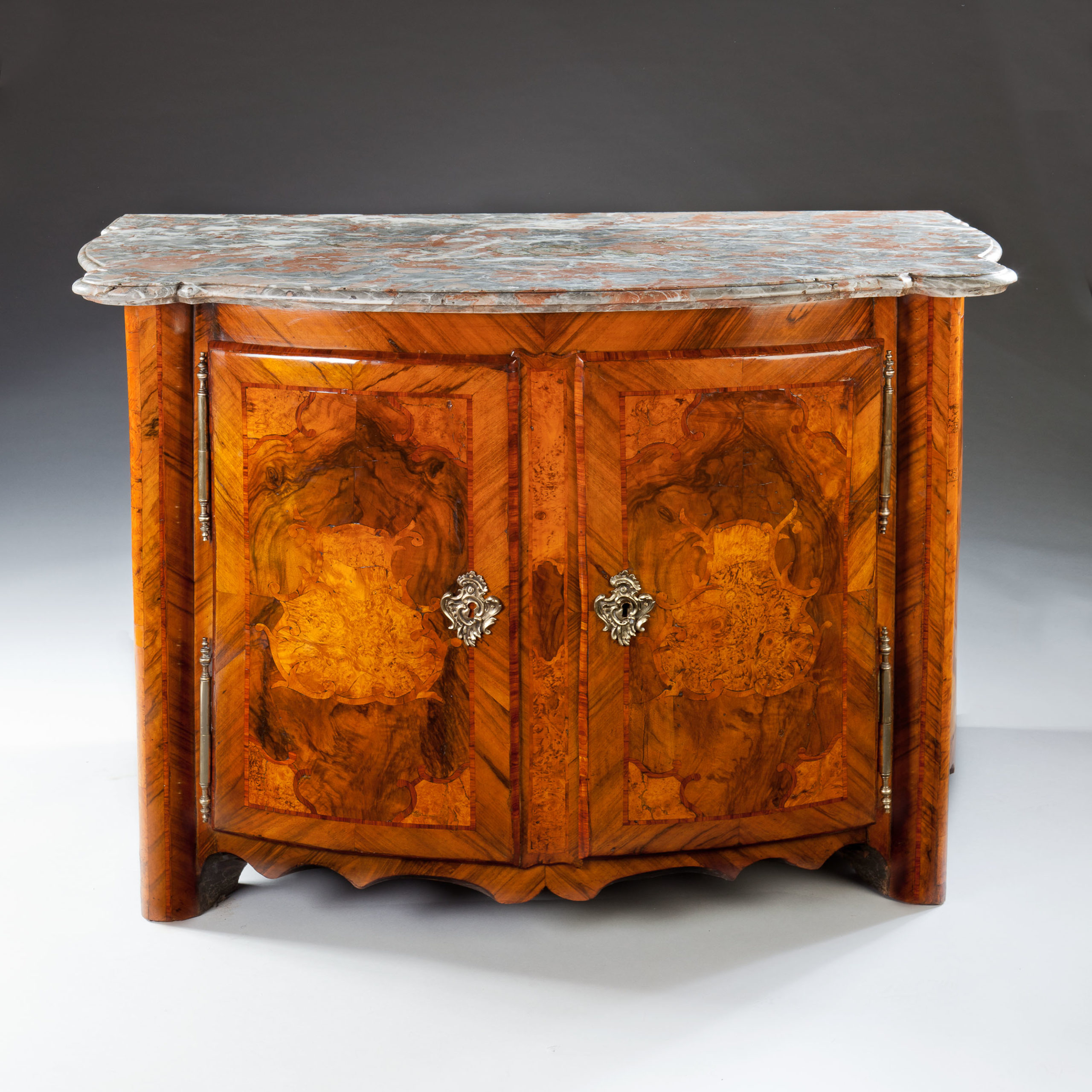 A magnificent and very rare early 18th century two door marquetry cabinet, retaining the original mottled marble top and veneered throughout in fine and highly figured woods of walnut, burr elm and kingwood, the two doors opening to a oak lined interior revealing the oak carcass, the whole raised on bracket feet.