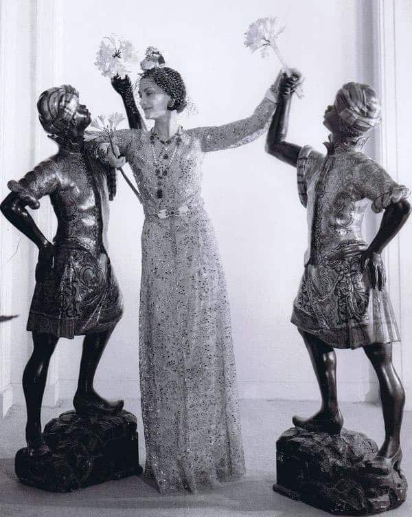 Coco Chanel with a Pair of Blackamoor sculptures