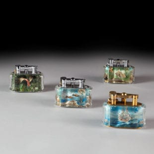 Collection of four Dunhill Aquarium Table Lighters including a 'Ship Lighter'