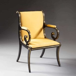 EBONISED AND BRASS REGENCY DESK CHAIR