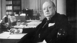 Sir Winston Churchill at his desk in Chartwell